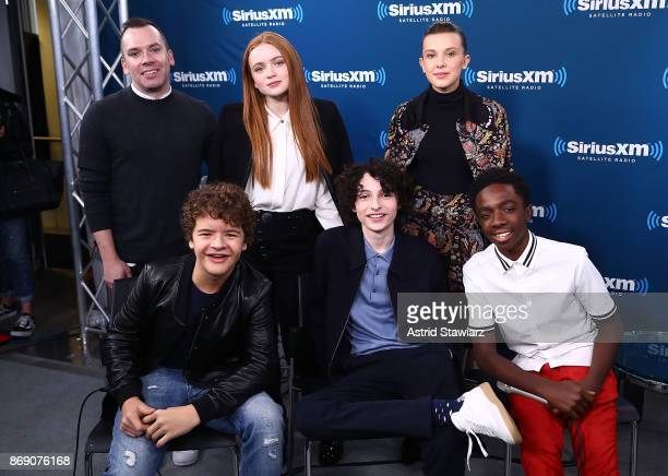 SiriusXM host Tim Stack poses for photos with actors Sadie Sink Millie Bobby Brown Caleb McLaughlin Finn Wolfhard and Gaten Matarazzo during...