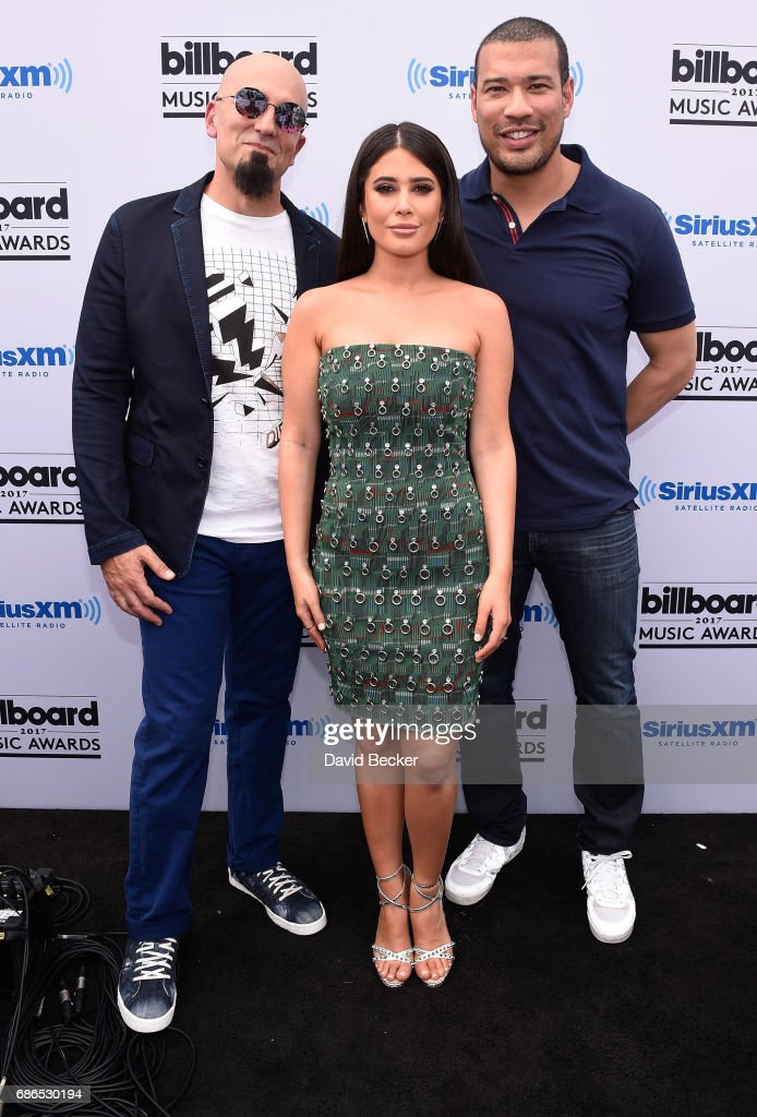 SiriusXM hosts Tony Fly, Symon and Michael YoÊpose at SiriusXM's 'Hits 1 in Hollywood' red carpet broadcast on SiriusXM's SiriusXM Hits 1 channel before the Billboard Music Awards at the T-Mobile Arena on May 21, 2017 in Las Vegas, Nevada.