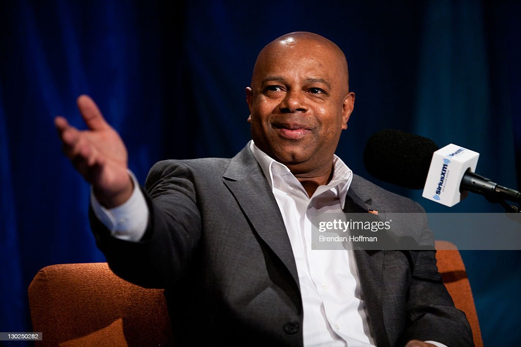 SiriusXM Patriot host David Webb gestures toward the studio audience during an interview with former Vice President Dick Cheney at SiriusXM studios on October 25, 2011 in Washington, DC. Cheney recently released his memoir, 'In My Time.'
