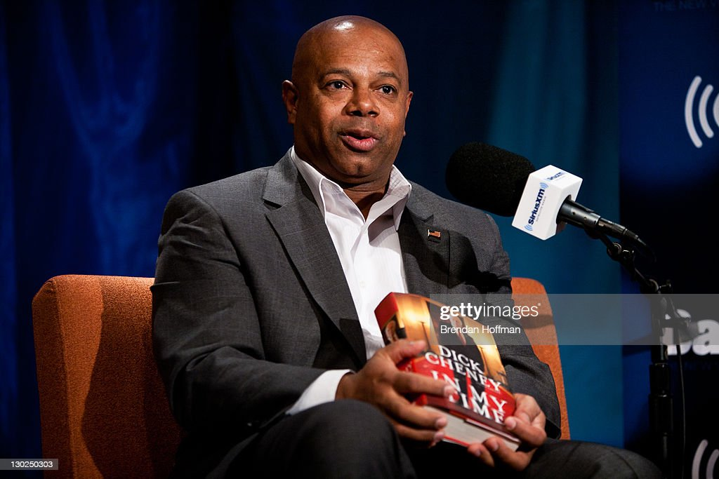 SiriusXM Patriot host David Webb holds a copy of former Vice President Dick Cheney's book 'In My Time' during an interview with Cheney at SiriusXM studios on October 25, 2011 in Washington, DC. Cheney is currently on a book tour for his new memoir.