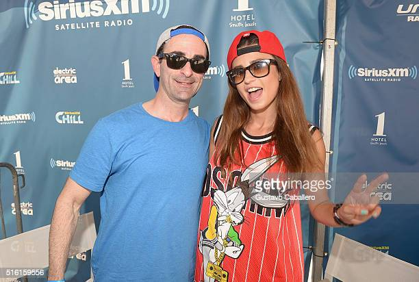 SiriusXM's Danny Valentino poses with Juicy M at SiriusXM Celebrates 10th Anniversary Of The SiriusXM Music Lounge At 1 Hotel South Beach Leading Up...