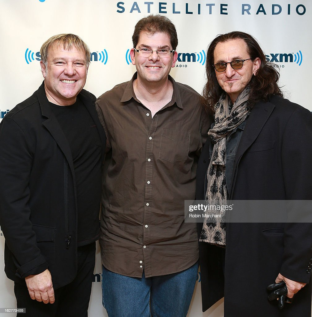 SiriusXM's Jon Hein (C) with Musicians <a gi-track='captionPersonalityLinkClicked' href=/galleries/search?phrase=Alex+Lifeson&family=editorial&specificpeople=228149 ng-click='$event.stopPropagation()'>Alex Lifeson</a> and <a gi-track='captionPersonalityLinkClicked' href=/galleries/search?phrase=Geddy+Lee&family=editorial&specificpeople=212809 ng-click='$event.stopPropagation()'>Geddy Lee</a> of Rush visit at the SiriusXM Studios on February 26, 2013 in New York City.