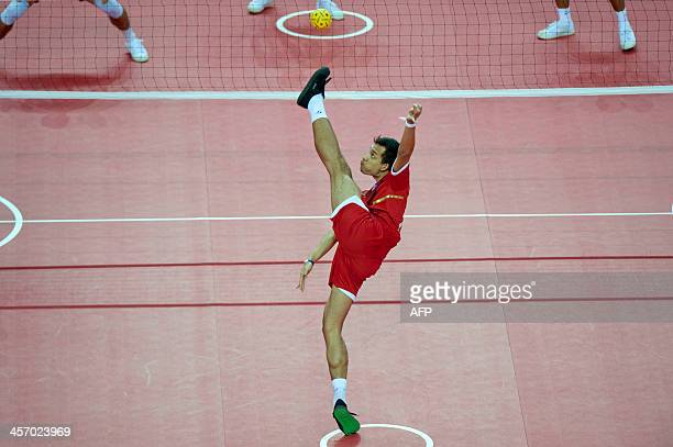 Siriwat Sakh from Thailand kick the ball to Malaysia during the sepaktakraw competition Men's Regu final at the 27th SEA Games in Naypyidaw on...