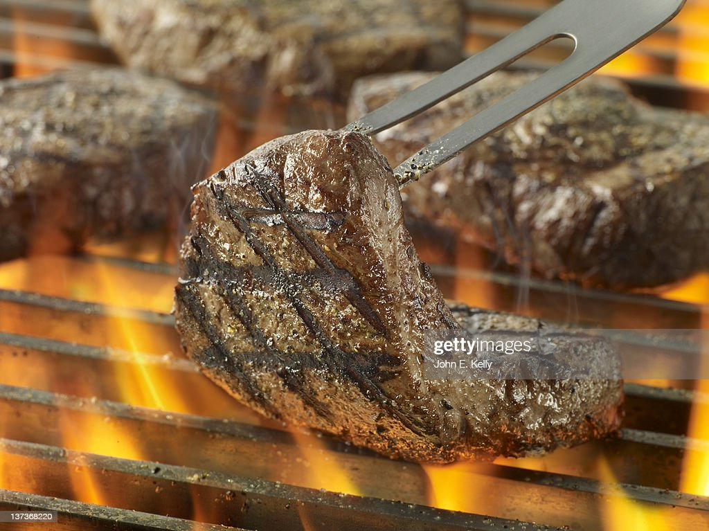 Sirloin Steak on Grill with Flames : Stock Photo
