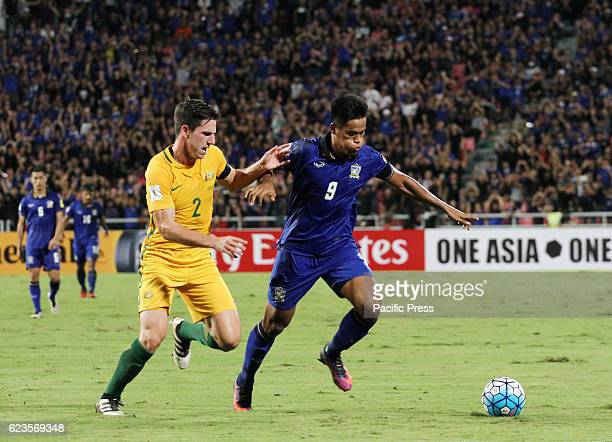 Sirod Chattong players of Thailand Milos Degenek of Australia player fights for the ball with during their World Cup 2018 Asia qualifying football...
