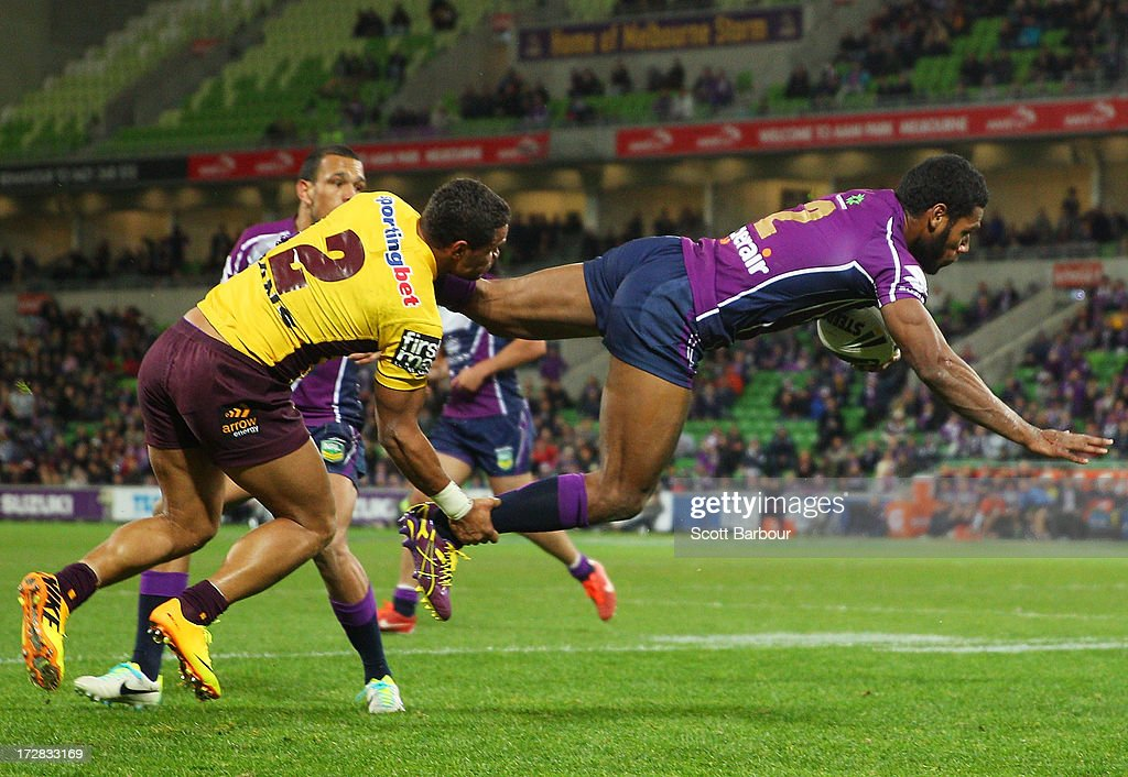 Sisa Waqa of the Storm is tackled by Josh Hoffman of the Broncos during the round 17 NRL match between the Melbourne Storm and the Brisbane Broncos at AAMI Park on July 5, 2013 in Melbourne, Australia.