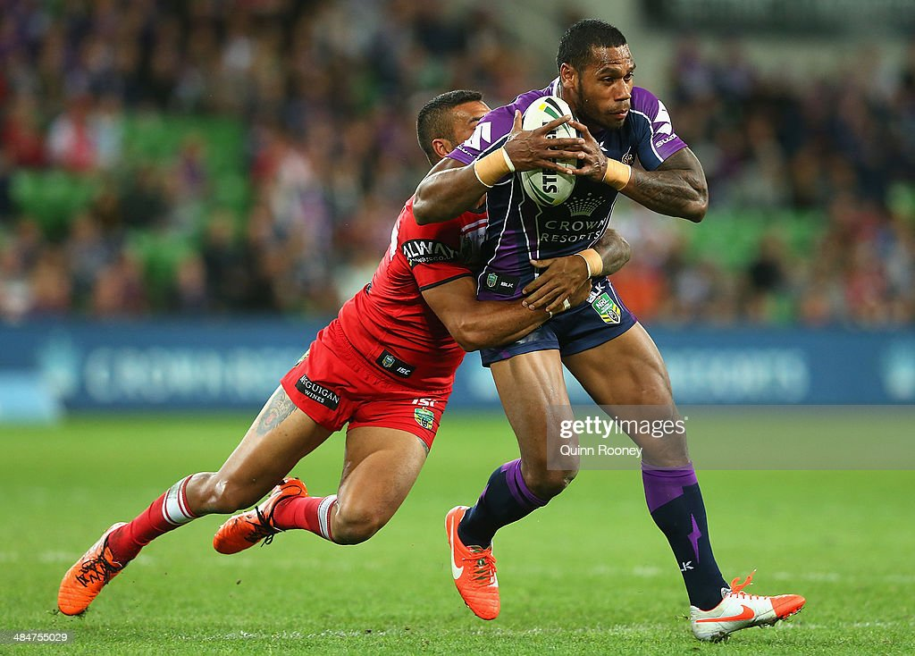 Sisa Waqa of the Storm is tackled during the round 6 NRL match between the Melbourne Storm and the St George Illawarra Dragons at AAMI Park on April 14, 2014 in Melbourne, Australia.