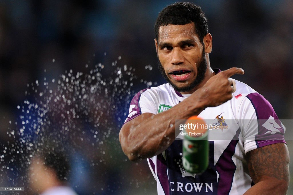 Sisa Waqa of the Storm throws a water bottle during the round 15 NRL match between the Gold Coast Titans and the Melbourne Storm at Skilled Park on June 24, 2013 on the Gold Coast, Australia.