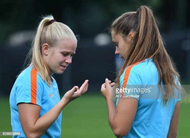 Sisca Folkertsma and Lieke Martens of The Netherlands attend a training session in the eve of the UEFA Women's Euro 2017 football tournament final...