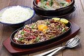 pork sisig and sinigang, filipino cuisine