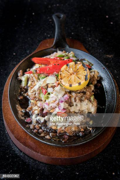 Sisig grilled chopped pork ears pork belly onions chili topped with liver cream aioli at Bistro 1521