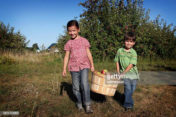 Sister and brother in an orchard