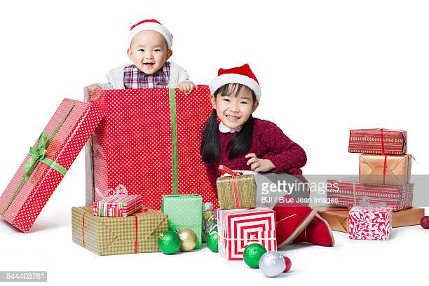 Sister and brother with Christmas gifts