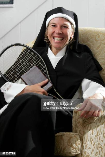 Sister Andrea Jaeger cradles her brown leather Bible and a tennis racket inside a cottage at a bedandbreakfast in Afton Va where she is staying while...