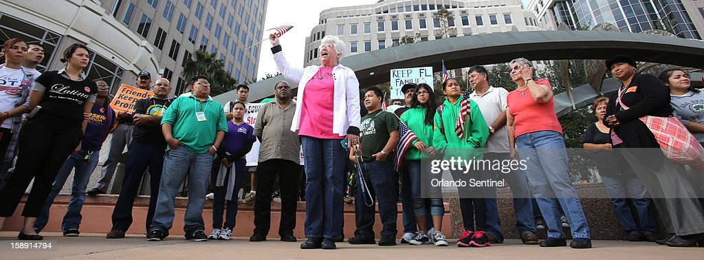 Sister Ann Kendrick, of the HOPE Community Center in Apopka, center, rallies with Hispanic immigration policy demonstrators from various groups in front of Orlando City Hall, before the group marched to Sen. Marco Rubio's office in downtown Orlando, Thursday, January 3, 2012.