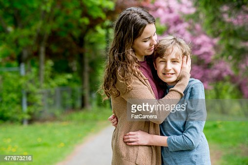 Sister Embracing Younger Brother