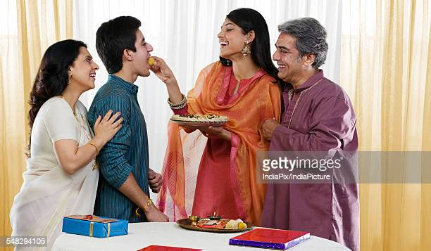 Sister feeding her brother during Rakhi