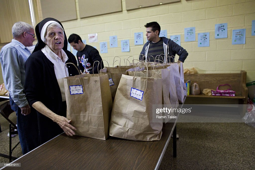 Sister Jeanine Conlon at Saint Charles Church prepares Thanksgiving meals to be delivered to the victims of Superstorm Sandy on November 22, 2012 in the Staten Island borough of New York City. Sections of Staten Island were hard hit by flooding from Superstorm Sandy.