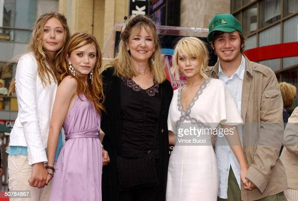 Sister Lizzie actress MaryKate mother Jarnette actress Ashley and brother Trent Olsen pose at the ceremony honoring Ashley and MaryKate with a star...