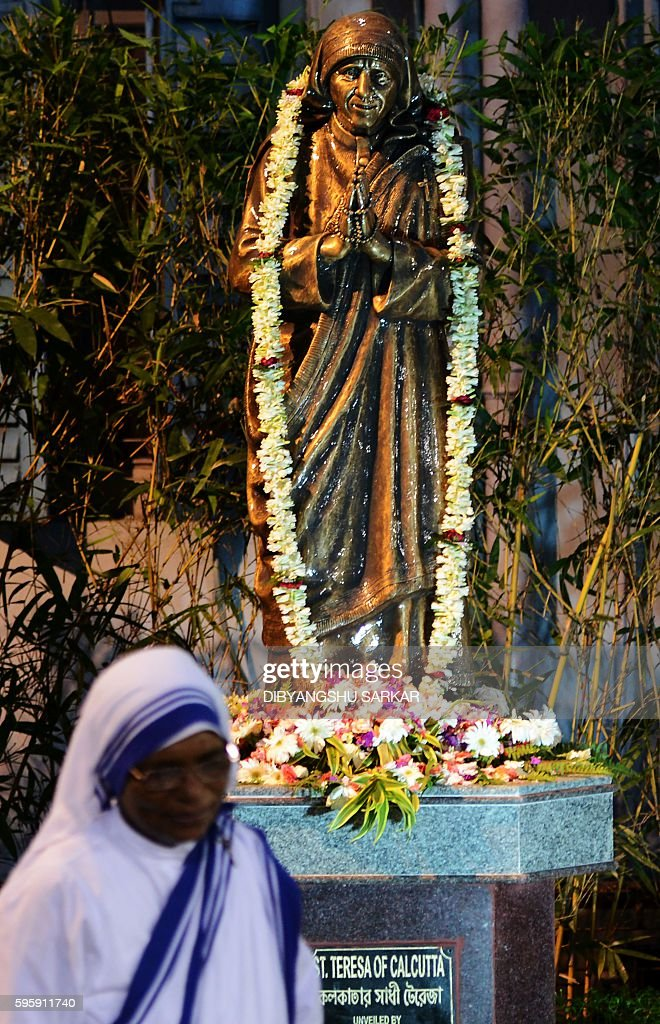 Sister Lysa a nun from the Catholic Order of the Missionaries of Charity looks on after unveiling a lifesize bronze statue of Mother Teresa at The...