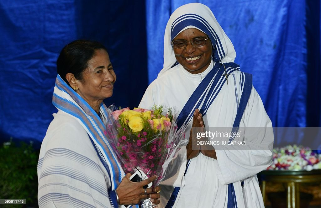 Sister Lysa a nun from the Catholic Order of the Missionaries of Charity welcomes the Chief Minister of the eastern Indian state of West Bengal...