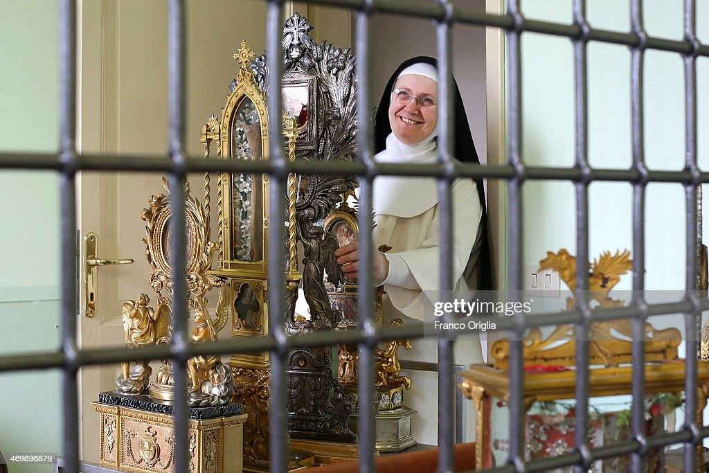 Sister Maria Domenica carries relics of Saint at the cloistered convent of St. Mary of the Rosary on February 6, 2014 in Vatican City, Vatican. The Dominican Nuns of St. Mary of the Rosary monastery supervise relics since the papacy of Pius IX (1860ca). Relics may be legitimately obtained from Church sources, the Vicariate in Rome, the religious Order of the Saint involved and the shrine of the Saint involved. When this is done, a donation is usually expected to cover the cost of the metal container (theca) that contains the relic, but in any case, a profit cannot legitimately be made from the sale of relics by anyone.