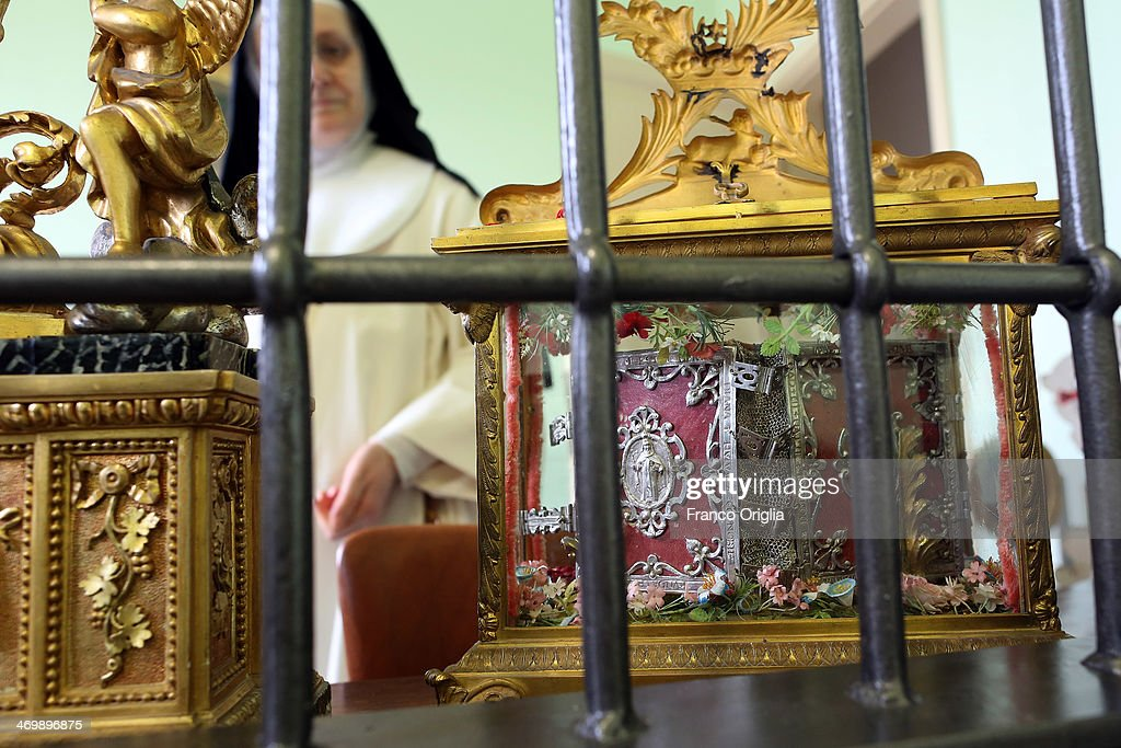 Sister Maria Domenica showes the breviary of Saint Dominic (1170-1221) at the cloistered convent of St. Mary of the Rosary on February 6, 2014 in Vatican City, Vatican. The Dominican Nuns of St. Mary of the Rosary monastery supervise relics since the papacy of Pius IX (1860ca). Relics may be legitimately obtained from Church sources, the Vicariate in Rome, the religious Order of the Saint involved and the shrine of the Saint involved. When this is done, a donation is usually expected to cover the cost of the metal container (theca) that contains the relic, but in any case, a profit cannot legitimately be made from the sale of relics by anyone.