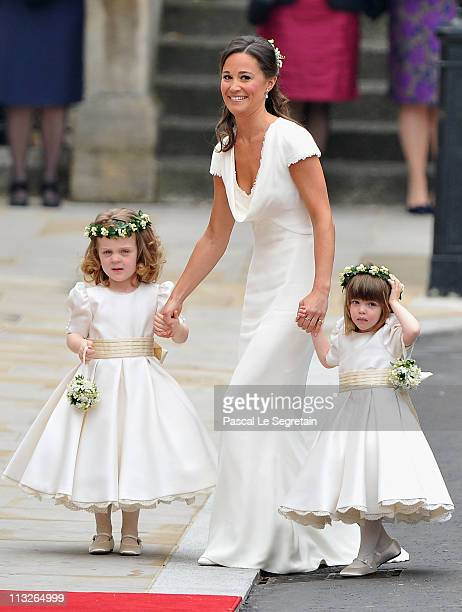 Sister of the bride and Maid of Honour Pippa Middleton holds hands with Grace Van Cutsem and Eliza Lopes as they arrive to attend the Royal Wedding...