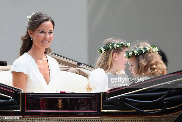 Sister of the bride and Maid of Honour Pippa Middleton makes her journey by carriage procession to Buckingham Palace following the Royal Wedding of...