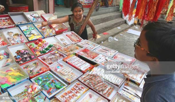 A sister points out her favourite rakhi to her brother on the eve of Raksha Bandhan Festival on August 6 2017 in Jaipur India Raksha Bandhan or...