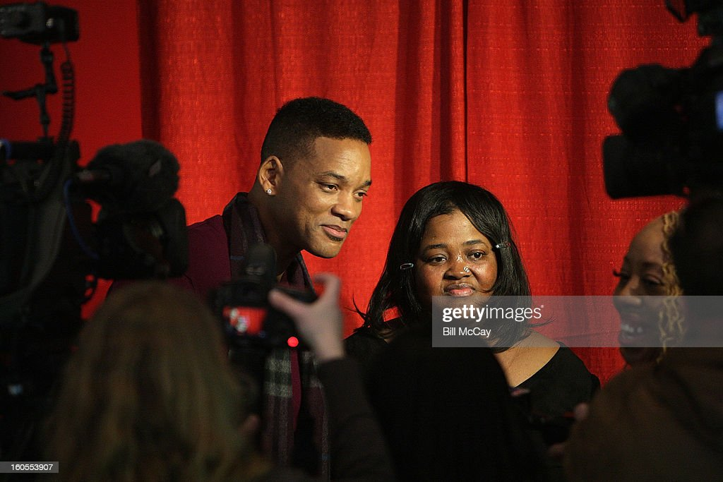 Sister Souljah and <a gi-track='captionPersonalityLinkClicked' href=/galleries/search?phrase=Will+Smith+-+Actor+-+Born+1968&family=editorial&specificpeople=156403 ng-click='$event.stopPropagation()'>Will Smith</a> attend the 'Real Talk' discussion of Sister Souljah's new novel 'A Deeper Love Inside: The Porsche Santiaga Story' at Temple Performing Arts Center February 2, 2013 in Philadelphia, Pennsylvania.