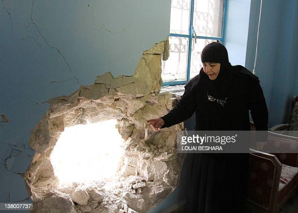 Sister Stefanie the head of the Sednaya Monastery shows journalists damage caused to the convent during a recent shelling on January 31 2012...