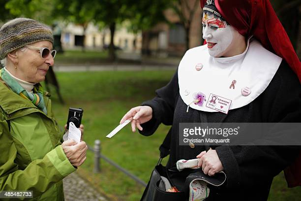 Sister Suzette talks to a woman during the ecumenical Good Friday procession on April 18 2014 in Berlin Germany Under the theme of 'Reformation and...