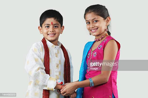 Sister tying rakhi to her brother