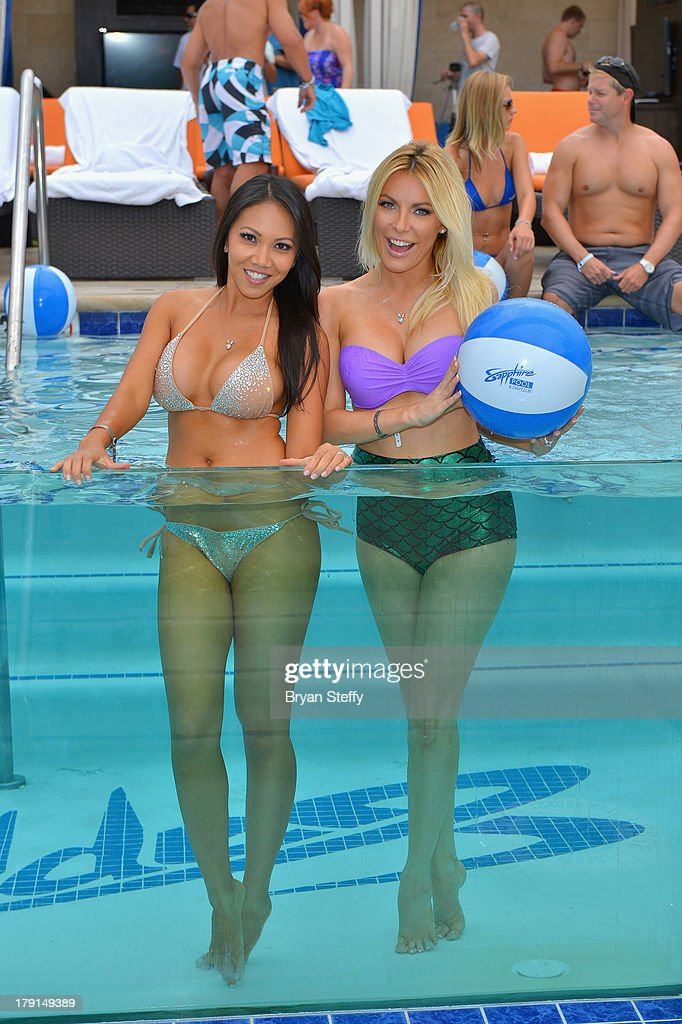Sister-in-law's model Caya Hefner (L) and television personality/model/DJ Crystal Hefner appear at the Sapphire Pool & Dayclub as Crystal hosts Labor Day weekend on August 31, 2013 in Las Vegas, Nevada.