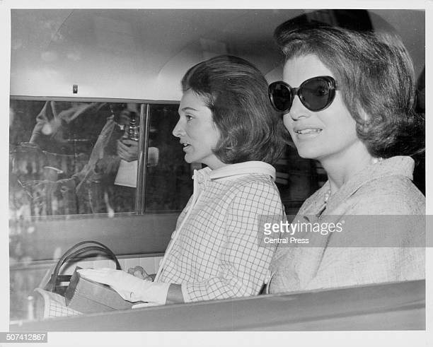 Sisters and socialites Princess Lee Radziwill and Jacqueline Kennedy sitting in the back of a car in London May 15th 1965
