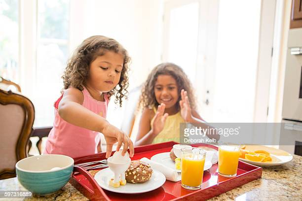 Sisters at home preparing breakfast