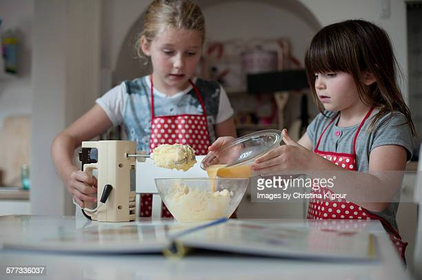 Sisters baking cakes together