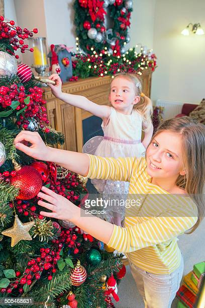 Sisters Decorating Christmas Tree