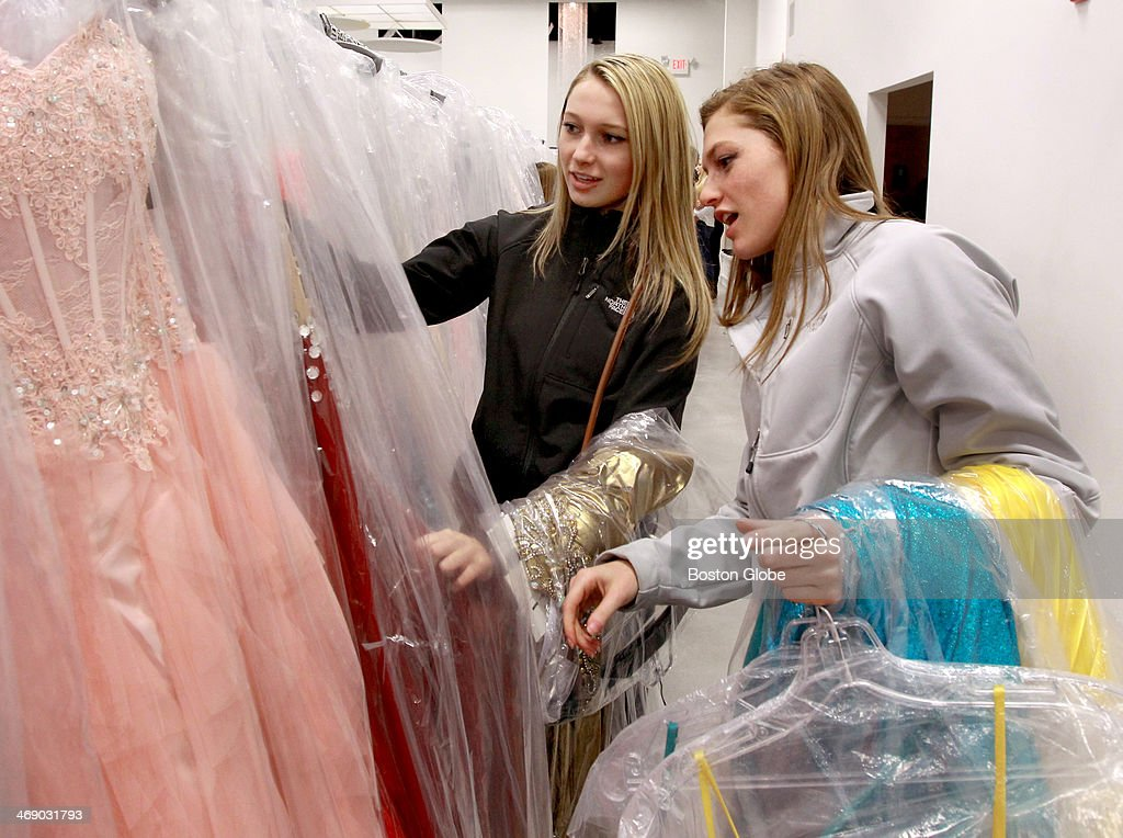Sisters Deirdre Somerville (left) and Melanie Somerville check out prom dresses at The Ultimate, a women's apparel store on Rt. 1 in Peabody, Mass. They are from Tewksbury and attend Tewksbury High School, where Deirdre is a junior and Melanie a senior. The store specializes in clothes for proms, social occasions, and evening wear.