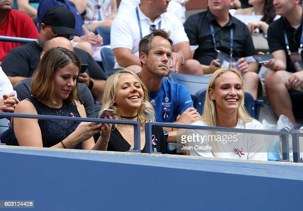 Sisters Djanaee Wawrinka and Naella Wawrinka girlfriend Donna Vekic of Croatia attend the men's final at Arthur Ashe Stadium on day 14 of the 2016 US...