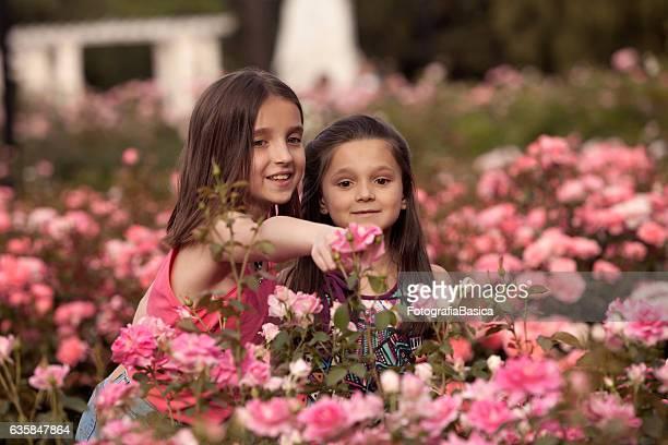 Sisters enjoying rose garden