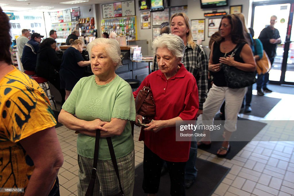 Connie Cataldo and Susan Fox, of Derry, N.H., wait in line to play Powerball at Ted's Stateline Mobil in Methuen.