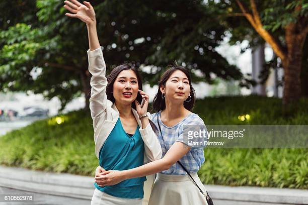 Sisters hailing a taxi in Osaka