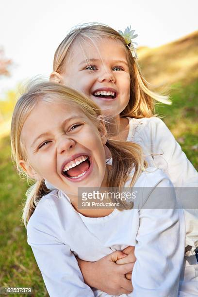 Sisters Laughing Together Outside