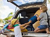 Sisters loading van for trip
