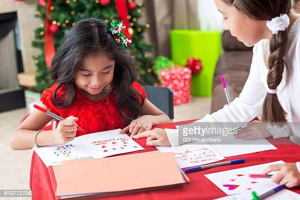Sisters make homemade cards at Christmastime
