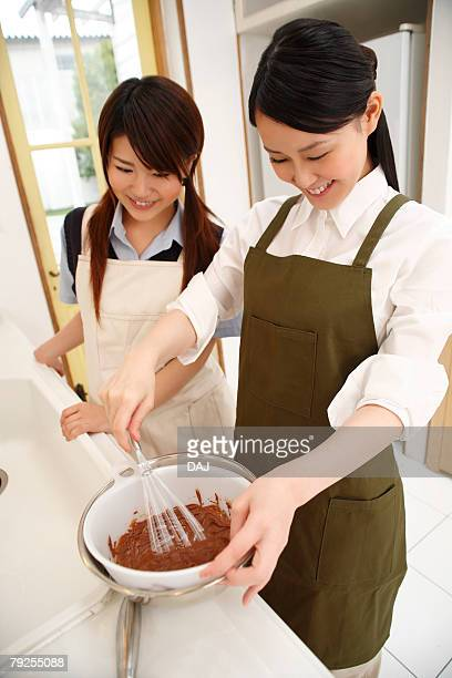 Sisters Making Sweets