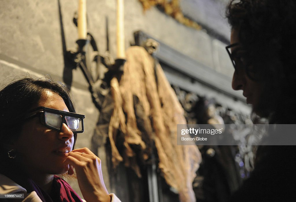 Sisters Noor Alkhatar, left, of Cambridge, and Moza Alkhatar, of Brookline, New York wait anxiously to enter the the Salem's 13 Ghosts Haunted House as they were their 3-D glasses.