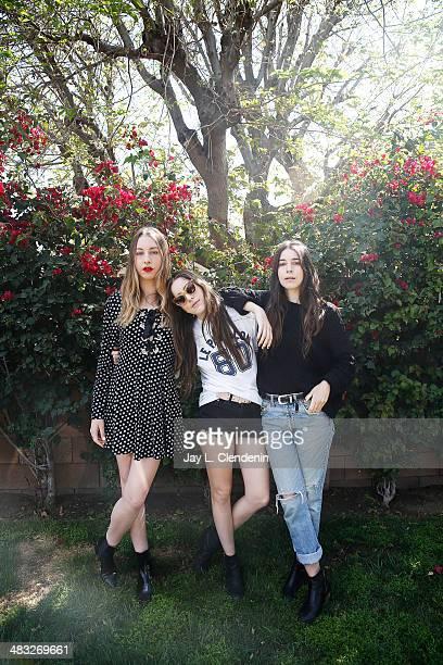 Sisters of the band Haim Danielle Haim Este Haim Alana Haim are photographed for Los Angeles Times on March 27 2014 in Studio City California...